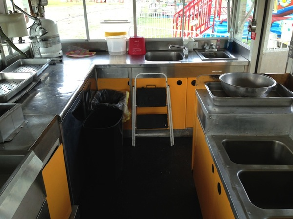 photo of a very nice french fry and corn dog trailer for sale on the midway marketplace